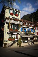 The quaint and decorative facade of Hotel Aarburg in Interlaken, Switzerland