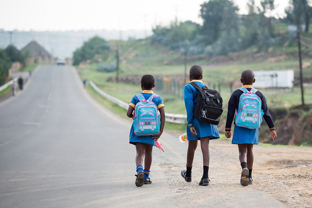 1 March 2017, Thaba Bosiu, Lesotho: Girls on the way to Thaba Bosiu Primary School, a public school accommodating some 100 children in Thaba Bosiu, Lesotho. Thaba Bosiu is a sandstone plateau some 24 kilometers east of Lesotho's capital, Maseru. The name means Night Mountain, and surrounding the plateau is a small village and open plains. Thaba Bosiu was once the capital of Lesotho, and the mountain was the stronghold of the Basotho king when the kingdom of Lesotho was formed.