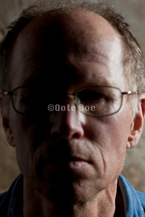 close up portrait adult man looking straight ahead