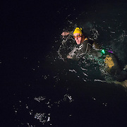 Triathlete Paul Parrish undertakes the swim section of his Arch to Arch triathlon attempt in the channel between England and France September 15, 2014. The Arch to Arc Triathlon is an ultra-distance triathlon starting with an 87 mile run from Marble Arch to Dover then a cross-channel swim to the French coast, and finishing with a 180 mile bike from Calais to to the Arch de Triomphe in Paris. REUTERS/Neil Hall (BRITAIN)