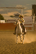 Girl rides horse in kids rodeo at Livingston Montana