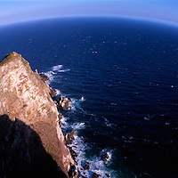 South Africa, Cape Hope Nature Reserve, Wind-swept waves crash near cliffs at Cape of Good Hope.