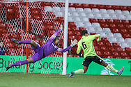 Brighton U18 Remi Meyers  and Brighton U18 goalkeeper Robert Lynch Sanchez  can't stop Nottingham Forest U/18   goal during the FA Youth Cup match between U18 Nottingham Forest and U18 Brighton at the City Ground, Nottingham, England on 10 December 2015. Photo by Simon Davies.