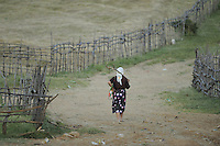 Going home from work in the fields. Lake Prespa National Park, Albania June 2009