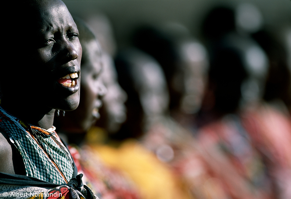 Maasai Tribe woman singing and dancing in remote village