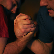 Competitors in action during The 14th Annual CT Fall Classic, Arm Wrestling Challenge held at the City Sports Grille, Bristol, Connecticut, USA. 16th October 2013. Photo Tim Clayton