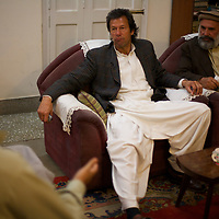 At the end of a long day meeting constituents in Mianwali, Imran Khan drops in on a party to celebrate his cousin's marriage. Imran Khan became a Member of the Pakistani Parliament for Mianwali, Panjab, in the October 2002 elections.<br /> <br /> Cricketer Imran Khan made his Test debut against England in 1971. He became captain of the Pakistan team in 1982 and lead them to World Cup victory in 1992 after which he retired.<br /> <br /> Imran Khan established the Tehrik-e-insaaf (or Moverment for Justice) in 1996. Through Tehrik-e-insaaf, Khan has demanded that the Pakistan government make institutional reforms to address corruption and end the present dictatorship. Khan would like a more equitable distribution of resources in Pakistan, the granting key civil liberties and an increas in public service spending. He is particularly scathing of the relationship between President Musharraf and US President Bush.<br /> <br /> Photo: Tom Pietrasik<br /> Panjab, Pakistan<br /> 28th January 2006