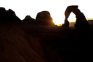 """Tourists climb to the base of Delicate Arch in Arches National Park to watch the sun rise over the rock formation. ytrew """"Delicate Arch"""""""