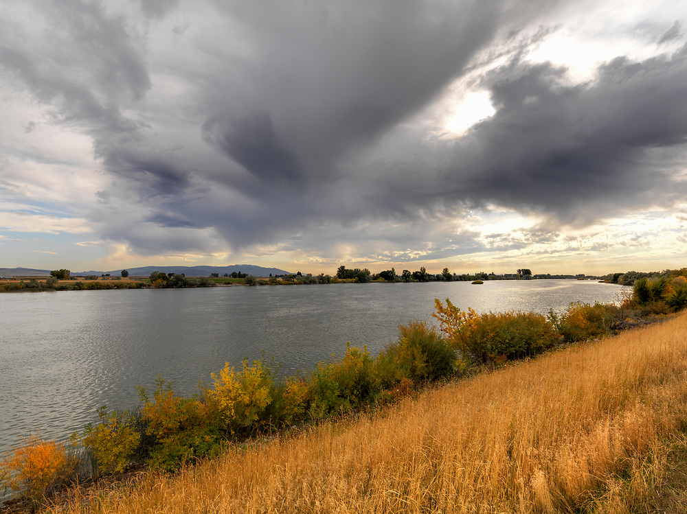 Brewing storm to the south of the Snake River near Rupert Idaho on an early fall day threatens the calm of the evening. Licensing and Open Edition Prints