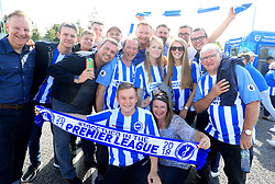 Brighton and Hove Albion fans pose for a picture prior to the Premier League match at the AMEX Stadium, Brighton.