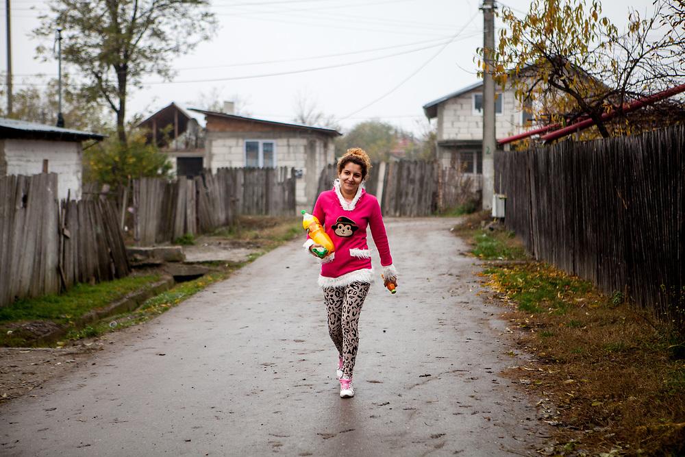A young woman walking the streets of Marginenii de Jos.