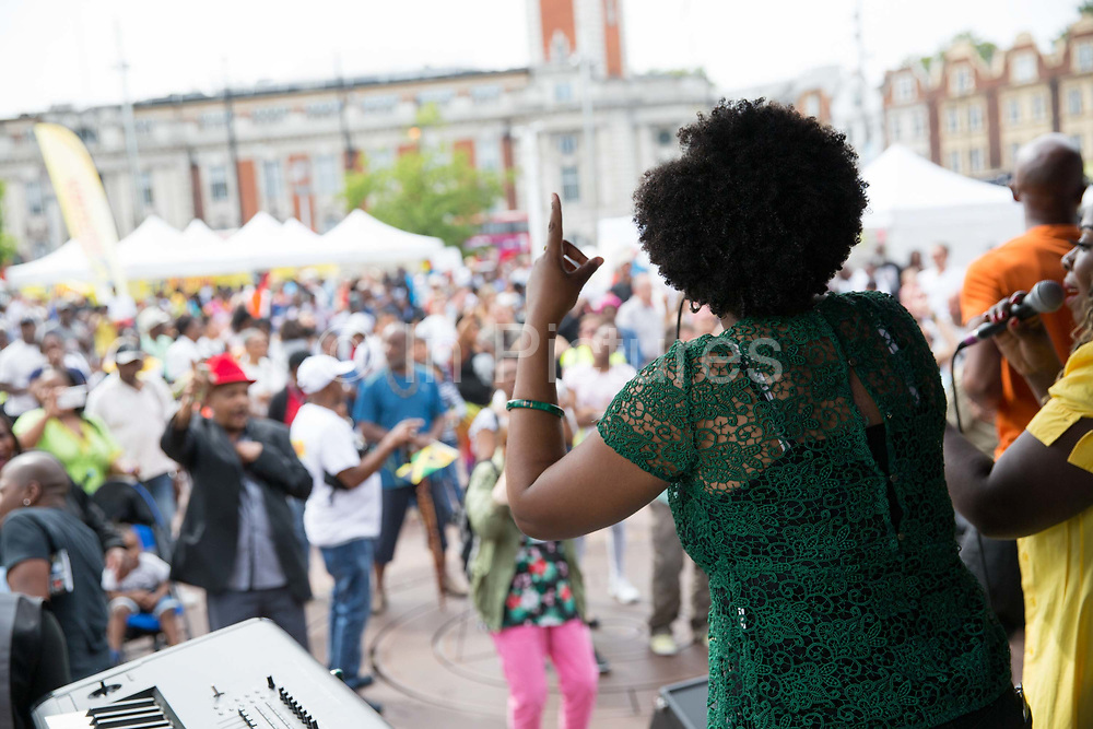 United Quest Choir play at Windrush Square to celebrate the 70th anniversary of the arrival of the passenger liner, Empire Windrush, and the men and women who came to England from the Caribbean on the 23rd June 2018 in Brixton in the United Kingdom. The arrival of 492 passengers from the Caribbean on the 22 June 1948 marked a seminal moment in Britain's history. (photo by Sam Mellish / In Pictures via Getty Images)