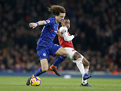 BRITAIN-LONDON-FOOTBALL-PREMIER LEAGUE-ARSENAL VS CHELSEA.(190120) -- LONDON, Jan. 20, 2019  Chelsea's David Luiz (L) is tackled by Arsenal's Alexandre Lacazette during the English Premier League match between Arsenal and Chelsea at the Emirates Stadium in London, Britain on Jan. 19, 2019. Arsenal won 2-0.  FOR EDITORIAL USE ONLY. NOT FOR SALE FOR MARKETING OR ADVERTISING CAMPAIGNS. NO USE WITH UNAUTHORIZED AUDIO, VIDEO, DATA, FIXTURE LISTS, CLUB/LEAGUE LOGOS OR ''LIVE'' SERVICES. ONLINE IN-MATCH USE LIMITED TO 45 IMAGES, NO VIDEO EMULATION. NO USE IN BETTING, GAMES OR SINGLE CLUB/LEAGUE/PLAYER PUBLICATIONS. (Credit Image: © Matthew Impey/Xinhua via ZUMA Wire)