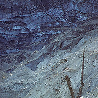A retreating glacier front descends from the Annapurna Massif near Manang, Nepal.
