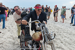Bill Buckingham helps his riding partner Sean Duggan push his 1936 Harley-Davidson Knucklehead passes through the start on the sands of Daytona Beach at the beginning of Stage 1 of the Motorcycle Cannonball Cross-Country Endurance Run, which on this day ran from Daytona Beach to Lake City, FL., USA. Friday, September 5, 2014.  Photography ©2014 Michael Lichter.