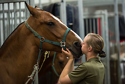 © London News Pictures. 14/07/2015.  Gunner Christie Farren gives Stumpy the horse a big kiss.. More usually associated with the ceremonial gun salutes and musical rides with their 13lb guns, they took on the role of both mounted and dismounted guard at the entrance of Horse Guards. This year, for the first time, they are using Knightsbridge Barracks, the home of the Household Cavalry Mounted Regiment, for the period of their duty, as opposed to Wellington Barracks, which they have used in previous years.  Photo credit: Sergeant Rupert Frere/LNP