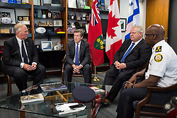 Minister of Border Security and Organized Crime Reduction Bill Blair, left to right, Toronto Mayor John Tory, Ontario Premier Doug Ford, and Toronto Police Chief Mark Saunders discuss Sunday's fatal shooting in Toronto, ON, Canada, on Monday, July 23, 2018. Photo by Nick Kozak/CP/ABACAPRESS.COM