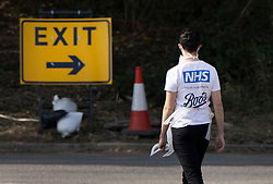 © Licensed to London News Pictures. 19/09/2020. Chessington, UK. A member of staff wearing a 'NHS Proudly supported by Boots' t-shirt waits for people to arrive at a Covid-19 testing centre set up in the car park of Chessington World of Adventures south west of London. The Government have faced criticism over delays in getting tested for the COVID-19 strain of coronavirus. . Photo credit: Peter Macdiarmid/LNP