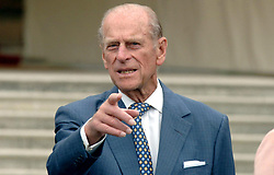 File photo dated 13/07/06 of the Duke of Edinburgh pointing the way as he and Queen Elizabeth II met guests at a garden party to mark 50 years of his award scheme at Buckingham Palace. He was the Queen's husband and the royal family's patriarch, but what will the Duke of Edinburgh be remembered for? Issue date: Friday April 4, 2021.