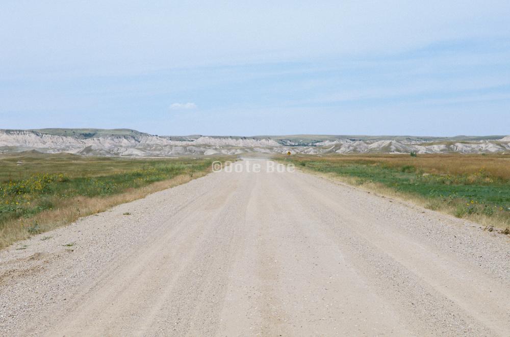 Dirt road through Badlands National Park US.