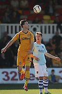 Andrew Hughes of Newport wins a header against Tom Nichols of Exeter (r). Skybet football league two match, Newport county v Exeter city at Rodney Parade in Newport, South Wales on Sunday 16th March 2014.<br /> pic by Mark Hawkins, Andrew Orchard sports photography.