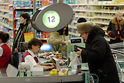 Moscow, Russia, 03/01/2004..Busy check-outs at the Mosmart shopping mall.