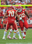 KANSAS CITY, MO - SEPTEMBER 15:  Defenders Dontari Poe #92 and Mike DeVito #70 of the Kansas City Chiefs react after a play against the Dallas Cowboys during the first half on September 15, 2013 at Arrowhead Stadium in Kansas City, Missouri.  (Photo by Peter G. Aiken/Getty Images) *** Local Caption *** Dontari Poe;MIke Devito
