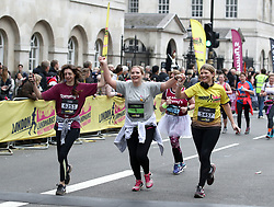 Runners react as they cross the finish line of the 2018 London Landmarks Half Marathon. PRESS ASSOCIATION Photo. Picture date: Sunday March 25, 2018. Photo credit should read: John Walton/PA Wire