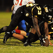 Topsail High School's Jacob Batts recovers a fumble against Pender High School Friday August 30, 2013 at Topsail High School. (Jason A. Frizzelle) This collection of images is from the 2013 High School Football in the Cape Fear region.