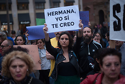 April 26, 2018 - Malaga, Spain - A woman holds up a placard that reads: ''Sister, I believe you'' as she takes part in a demonstration against the sexual abuse to women. Thousand of people take the street in Malaga to protest against the sentence of 9 years in prison to five men (known as 'La Manada') acussed of sexual group rape of an 18-year-old woman during  the San Fermin Festival in 2016. (Credit Image: © Jesus Merida/SOPA Images via ZUMA Wire)