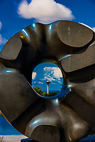 """Looking at the Space Needle through the sculpture titled """"Black Sun"""", created 1969 by Isaumu Noguchi; Volunteer Park, Seattle, Washington USA."""