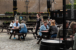 Pubs with beer gardens are back in action in Scotland from today.  The Pear Tree and 56 North in Edinburgh asked customers to book socially distanced tables for two-hour slots.  This is to protect staff and customers alike.  All details of booked clients are retained and temperatures taken before anybody is permitted in the Covid 19 free zone. Operations manager for the Pear Tree, Brian Dobie was keen to show customers that the bar was taking their responsibilities seriously with only table service for all food and drink.  Any walk up customers to 56 North have to provide their contact details to ensure any health issues can be traced if required.