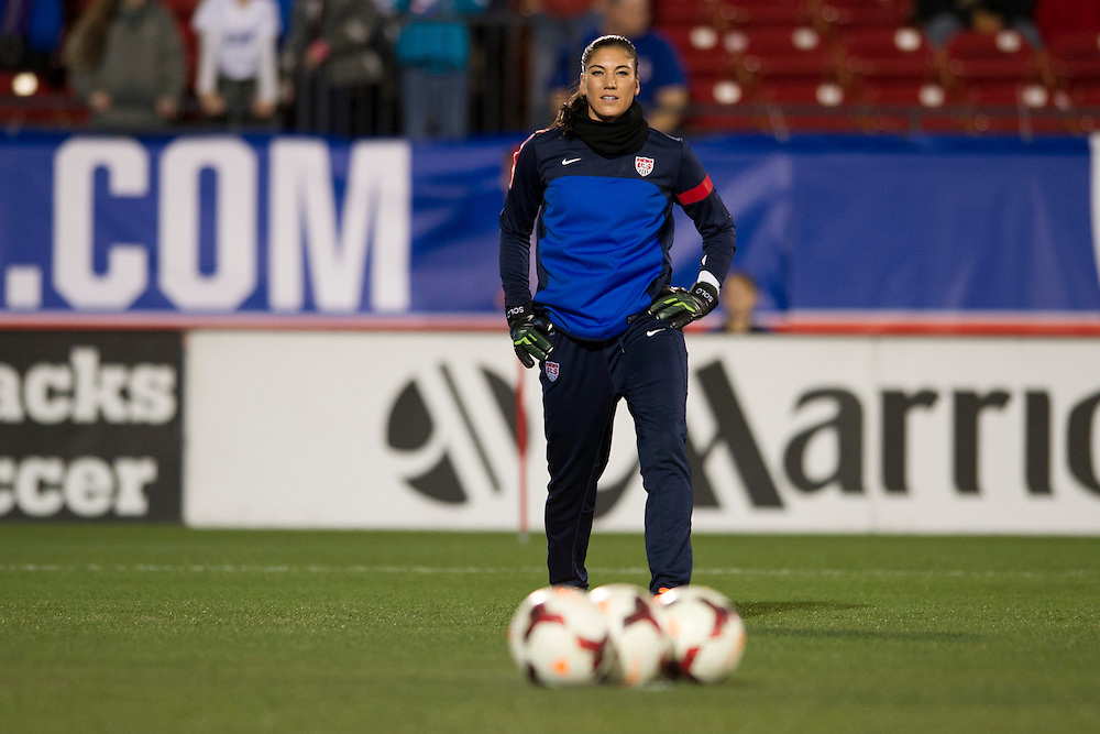 FRISCO, TX - JANUARY 31:  Hope Solo #1 of the U.S. Women's National Team warms up before an international friendly against the Canadian Women's National Team on January 31, 2014 at Toyota Stadium in Frisco, Texas.  (Photo by Cooper Neill/Getty Images) *** Local Caption *** Hope Solo