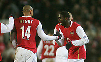 Photo: Paul Thomas.<br /> Blackburn Rovers v Arsenal. The Barclays Premiership. 13/01/2007.<br /> <br /> Goal scorer Kolo Toure (R) of Arsenal is congratulated by captain Thierry Henry.
