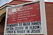April 4, 2020, New Orleans, Louisiana - Church sign asking people to wash hands and cough in their elbows as well as prya in the Lower Ninth Ward in New Orleans while the COVID-19 Pandemic worsens.
