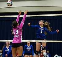 Interlakes Aria Shufelt goes up for a block off a spike from Winnisquam's Gabby Isabelle during NHIAA Division III volleyball on Wednesday evening.  (Karen Bobotas/for the Laconia Daily Sun)