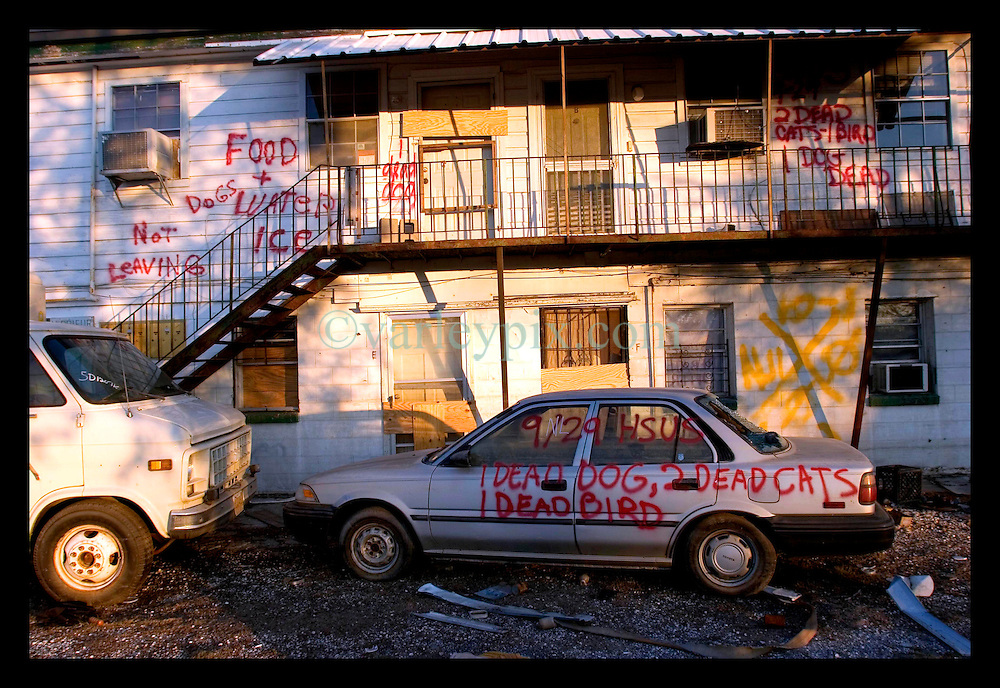 21st, December 2005. New Orleans, Louisiana. Rescue workers graffiti lingers on trucks, cars and walls of the devastated 9th Ward long after the devastating flood from Hurrican Katrina subsided.