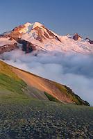 Clouds dissipating in the evening light around Mount Baker (elevation 10,778feet (3,285m). Seen from Chowder Ridge, Mount Baker Wilderness Washington USA