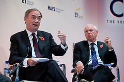 © London News Pictures. 04/11/2013 . London, UK.  SAM LAIDLAW, Chief Executive, Centrica plc (left) and Sir RICHARD OLVER, Non-executive chairman, BAE Systems (right), speaking during the 2013 Confederation of British Industry (CBI) Conference, held at the Hilton Metropole in London. . Photo credit : Ben Cawthra/LNP