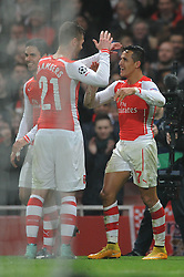 Arsenal's Alexis Sanchez celebrates his goal with Arsenal's Calum Chambers - Photo mandatory by-line: Dougie Allward/JMP - Mobile: 07966 386802 - 26/11/2014 - SPORT - Football - London - Emirates Stadium - Arsenal v Borussia Dortmund - Champions League - Group D