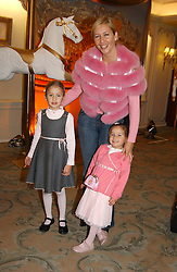 TANIA BRYER and her daughters NATASHA & FRANCESCA MOUFFARIGE  at a children's party in aid of the charity Over The Wall held at Fortnum & Mason, Piccadilly, London before a gala premiere of the new musical Mary Poppins at The Prince of Wales Theatre, Old Compton Street, London W1<br />