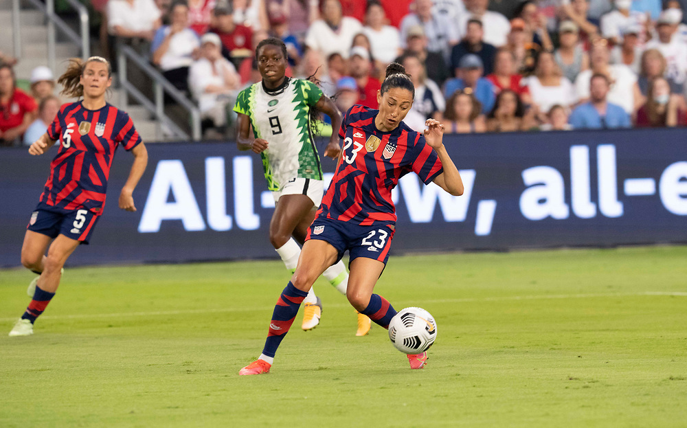 USA's CHRISTEN PRESS (23) heads to the goal past TONI PAYNE (9) of Nigeria to score a goal in the first half as the US Women's National Team (USWNT) beats Nigeria, 2-0 in the inaugural match of Austin's new Q2 Stadium. The U.S. women's team, an Olympic favorite, is wrapping up a series of summer matches to prep for the Tokyo Games.