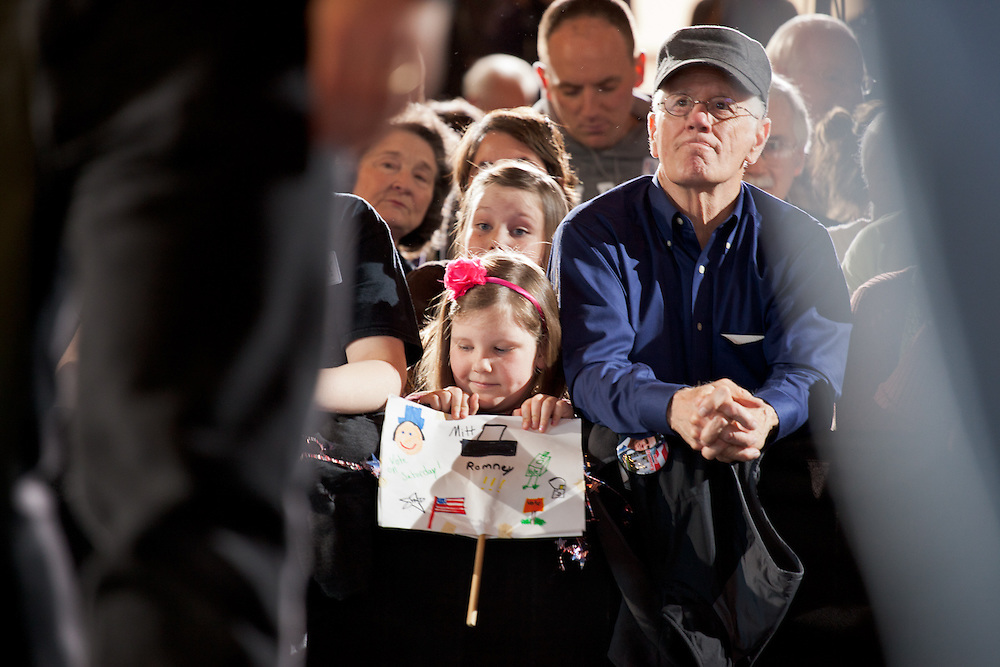 A young girl holds a homemade sign for Mitt Romney at his campaign stop at Winthrop University in Rock Hill, SC.