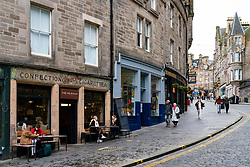Edinburgh, Scotland, UK. 14 November 2020. Views of Edinburgh city centre on Saturday afternoon during a level 3 lockdown imposed by the Scottish Government;.Pictured; Cafes and bars on Cockburn Street are quiet. Iain Masterton/Alamy Live News.
