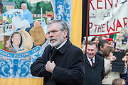 Gerry Adams. Tony Benn's funeral at 11.00am at St Margaret's Church, Westminster. His body was brought in a hearse from the main gates of New Palace Yard at 10.45am, and was followed by members of his family on foot. The rout was lined by admirers. On arrival at the gates it was carried into the church by members of the family. Thursday 27th March 2014, London, UK. Guy Bell, 07771 786236, guy@gbphotos.com