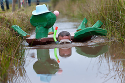 © Licensed to London News Pictures. 30/08/2015. Llanwrtyd Wells, Powys, Wales, UK. Dave Swift from Northampton dresses as a turtle for the event. World Bogsnorkelling Championships, conceived 30 years ago in a Welsh pub by landlord Gordon Green, are held every August Bank Holiday at Waen Rhydd Bog. Using unconventional swimming strokes, participants swim two lengths of a 55 metre trench cut through a peat bog wearing snorkel and flippers. The world record was broken in 2014 by 33 year old Kirsty Johnson from Lightwater, Surrey, in a time of 1 min 22.56 secs. Photo credit: Graham M. Lawrence/LNP