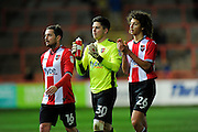 Matt Oakley (16) of Exeter City, Christy Pym (30) of Exeter City and Ethan Ampadu (26) of Exeter City walk from the pitch at full time during the EFL Sky Bet League 2 match between Exeter City and Luton Town at St James' Park, Exeter, England on 26 November 2016. Photo by Graham Hunt.