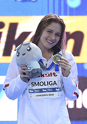 HANGZHOU, Dec. 12, 2018  Olivia Smoliga of the United States poses for photo during the awarding ceremony of Women's 100m Backstroke Final at 14th FINA World Swimming Championships (25m) in Hangzhou, east China's Zhejiang Province, on Dec. 12, 2018. Olivia Smoliga claimed the title with 56.19 seconds. (Credit Image: © Xinhua via ZUMA Wire)