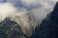 Sheer cliff rock wall and storm clouds, Yosemite Valley, Yosemite National Park, California