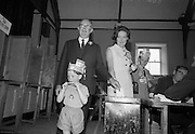 T F O'Higgins, a candidate in the 1966 Presidential Election, casts his vote at Dalkey Town Hall, accompanied by his wife,  and two of his sons, Shane (left), and Michael (right). O'Higgins came within 1% (or 10,000 votes) of defeating outgoing president Eamon de Valera. .01.06.1966